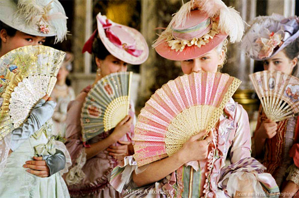 Kirsten Dunst as Marie Antoinette. Lace, paper and silk painted hand fans and over the top, feminine hats complement the beautiful costumes designed by Milena Canonero