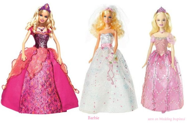 Barbie dolls in various pink gowns, including wedding dress with pink sash