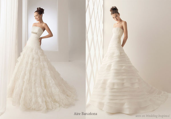 Horizontal ruffle layered lace silk wedding gown from bridal house Aire Barcelona
