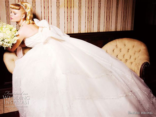 White wedding dress with a ball gown silhouette from Barbie Bridal