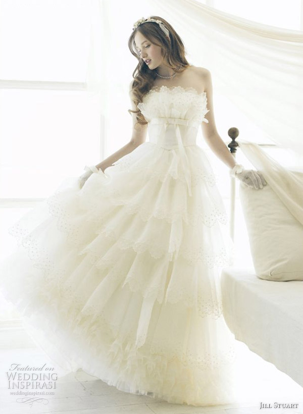 Layer of amazing ruffles and pleats on a gorgeous white wedding gown by American fashion designer Jill Stuart
