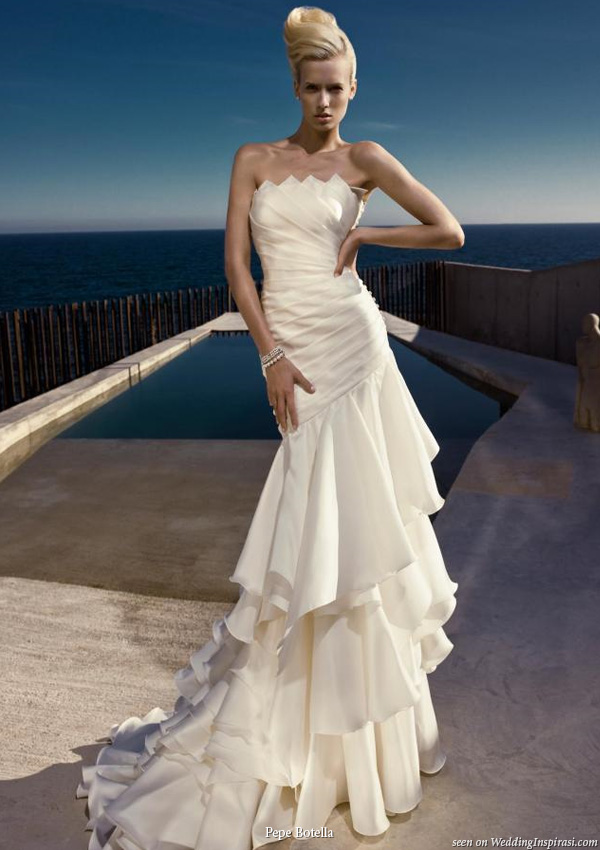Beautiful large ruffle tier strapless wedding gown by Pepe Botella Novias
