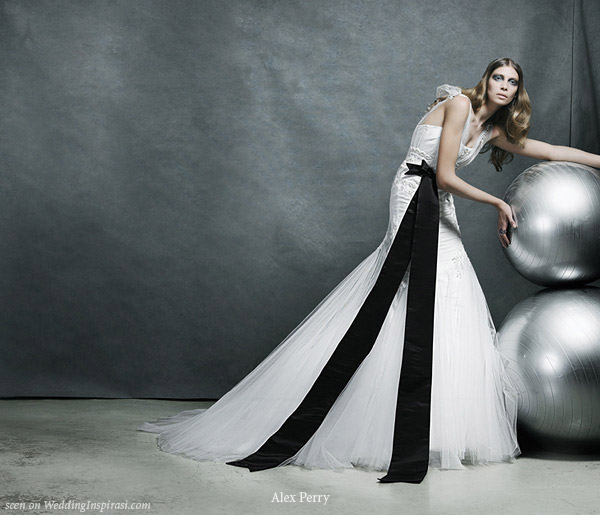 Wedding gown with large black bow detail designed by Alex Perry