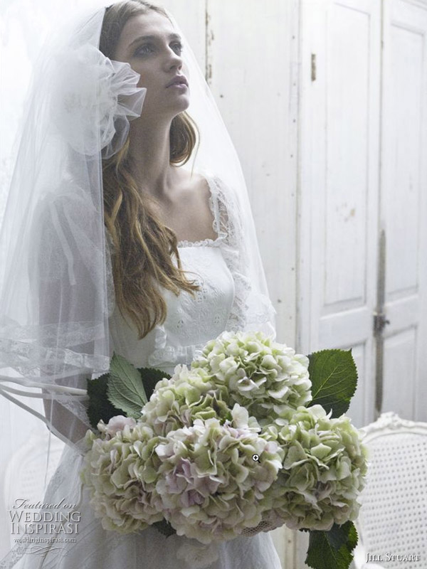 Flower veil and pretty feminine details on this romantic wedding dress by Jill Stuart