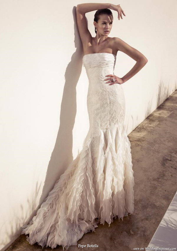 Strapless wedding dress with ruffle skirt by Spanish bridal design house Pepe Botella Novias