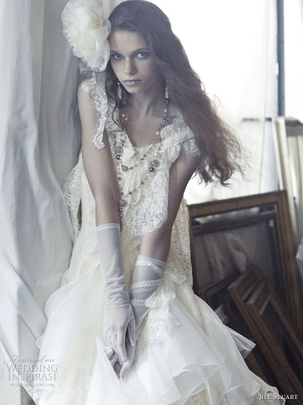 Shabby chic wedding gown worn with pearls and gloves by Jill Stuart