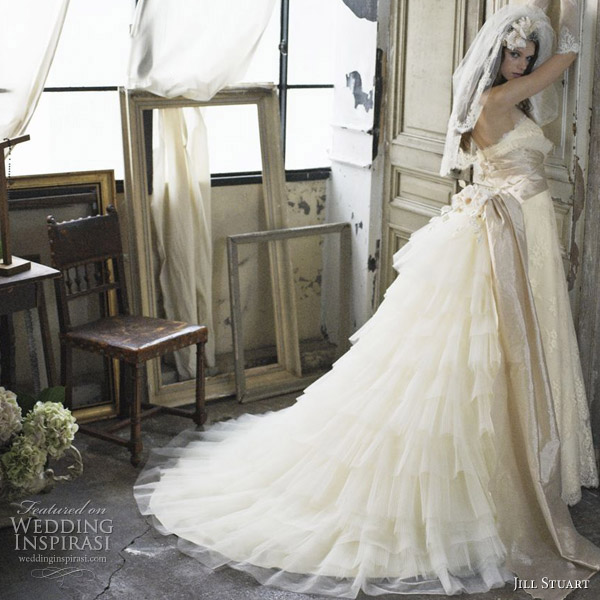 Beautiful wedding gowns with stunning ruffle bustle by Jill Stuart