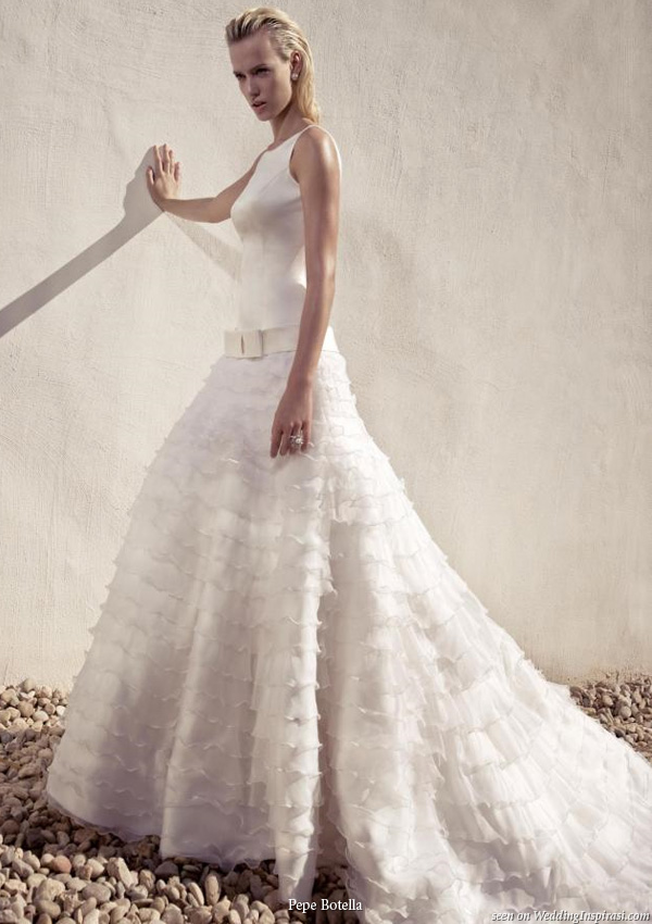 A gown Pepe Botello Novias collection: A-line wedding dress with mutitple tiers of ruffle