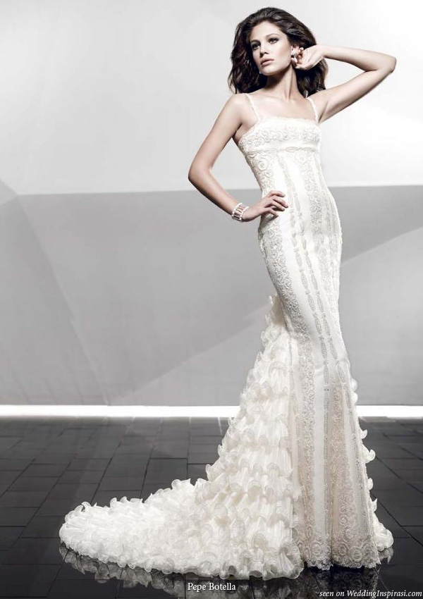 Fitted, slim, slinky and sexy wedding gown with romantic ruffle detail by Pepe Botella Novias