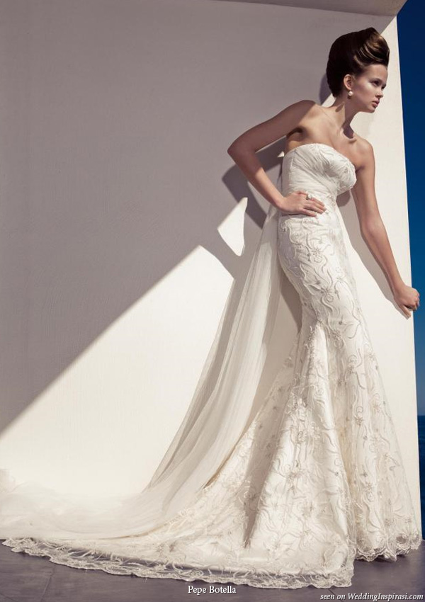 Gorgeous strapless wedding gown with train designed by Pepe Botella Novias