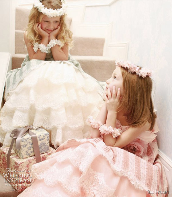 Pretty flower girls in white, green and pink with gifts wrapped with ribbons