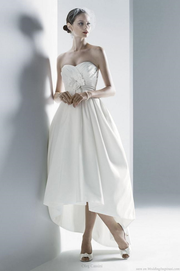 Wedding dress with asymmertric hem, short in front, long at the back, by Oleg Cassini