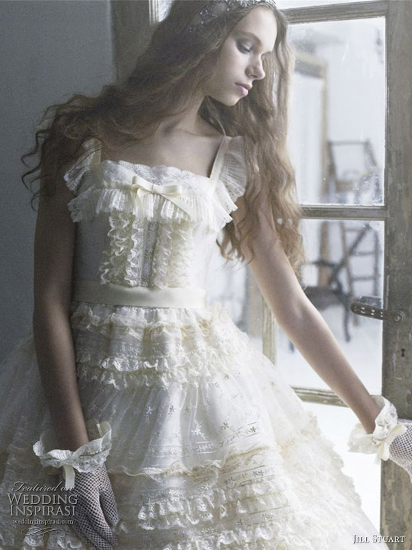 Ivory, yellow frilly ball gown with thick lace strap and gloves