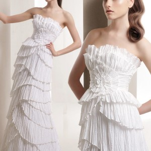 Strapless crinkle ruffle tiered wedding gown from W1 White One bridal house