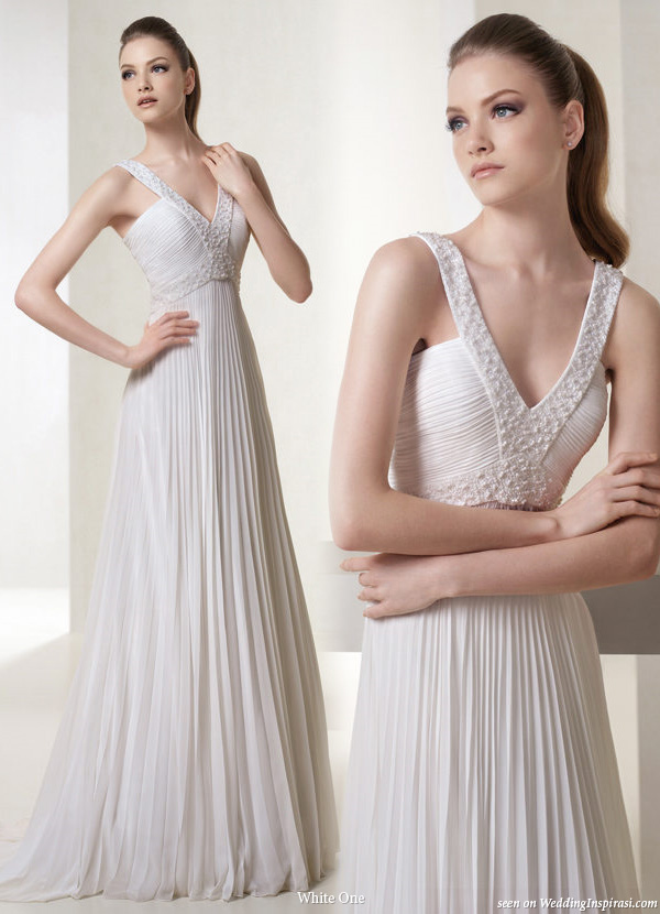 Love the slimming effect of the deep V strap Deep vneck wedding gown from