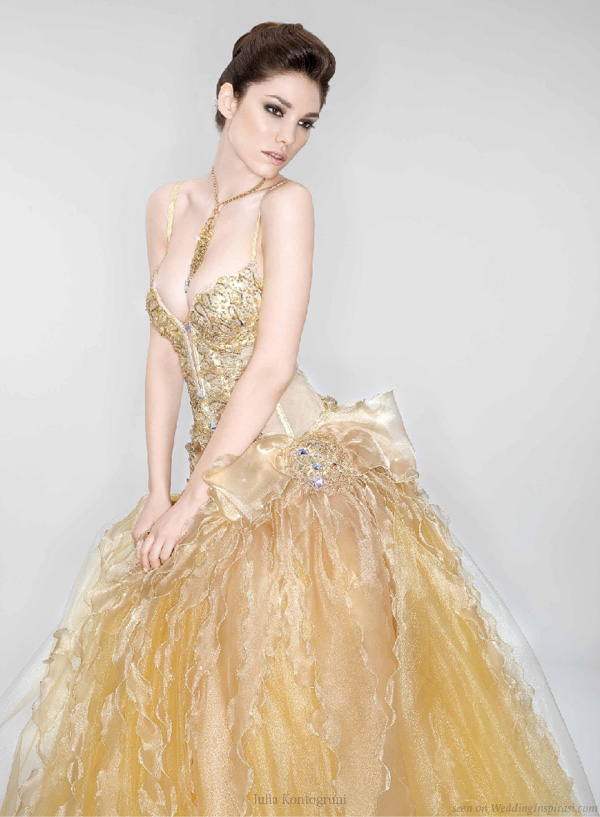 Rich gold wedding dress decorated with Swarovski crystals by Julia Kontogruni
