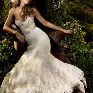 Ivory alencon lace net formal bridal gown, sweetheart neckline, fresh water pearl brooch at   natural waist with tie ribbon, soft A-line skirt with alencon lace applique over sparkle net   underlay, chapel train.