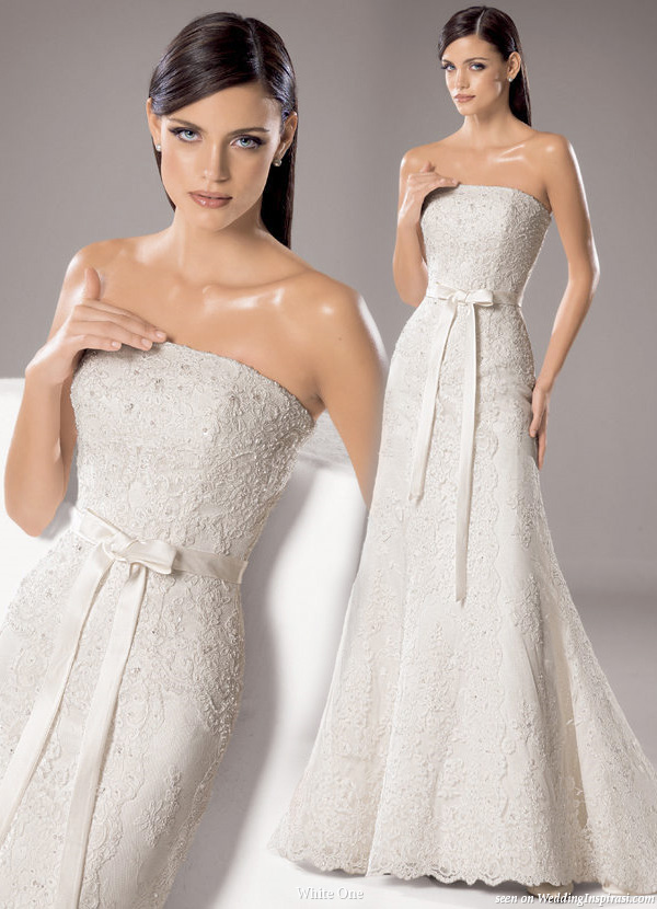 Elegant strapless white wedding gown with shiny bride from White One