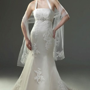 Venus Bridals Angel and Tradition collection wedding dress- Trumpet halter of Imperial Satin with New Tulle features appliques dotted with pearls, beading at the empire. Lace up back.