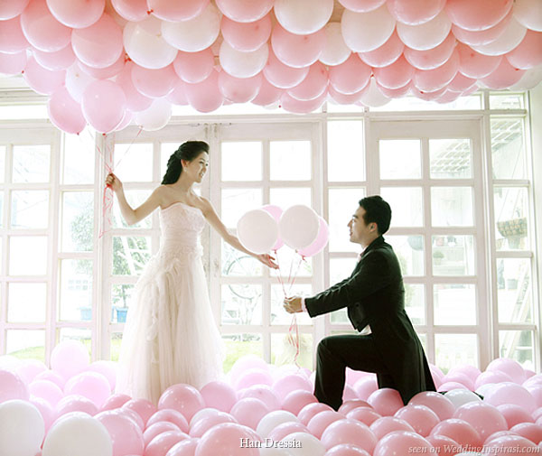 Fun wedding photo shoot with lots of pink, rose, cream and white balloons on the ceiling and floor by Korean bridal house Han Dressia