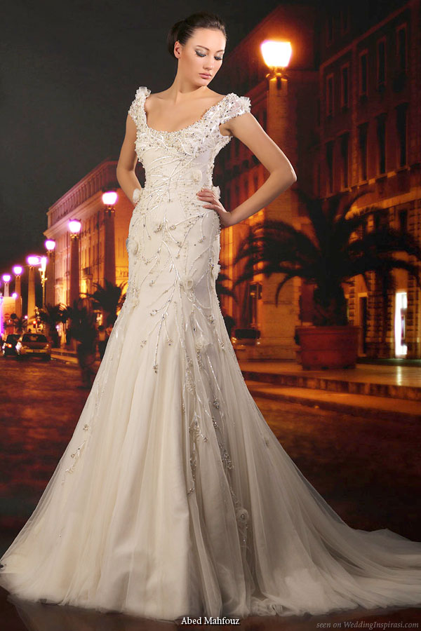 Wedding bridal gown with thick straps, slightly off-shoulder and fit and flare slight mermaid silhouette