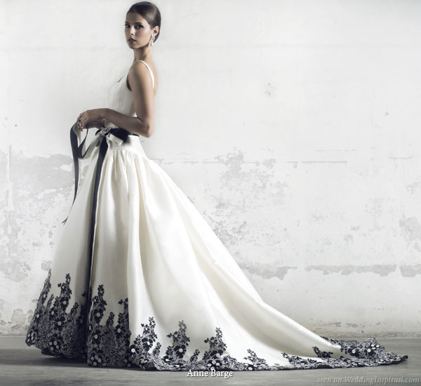 stunning white wedding gown with contrasting black hem accents and sash