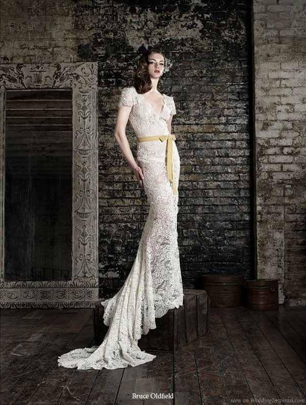 Lovely lace wedding gown with short or cap sleeves and train, worn with a mustard color sash at the natural waist