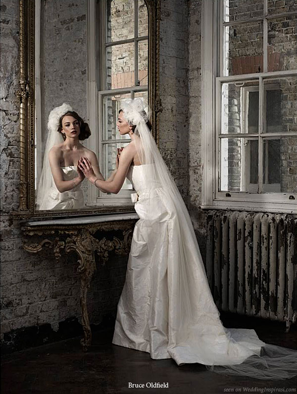 Mirror image- bride models a strapless wedding dress designed by UK based designer Bruce Oldfield for his bridal collection