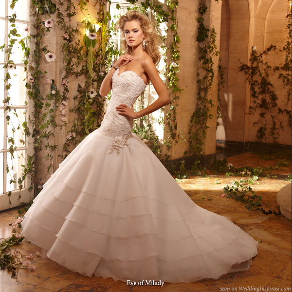 A deliciously sweet light pink strapless wedding gown for all ye Pink