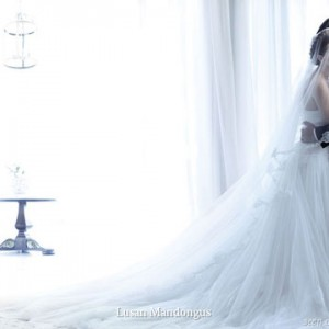 The perfect bridal gown for a romantic white wedding theme by Lusan Mandongus