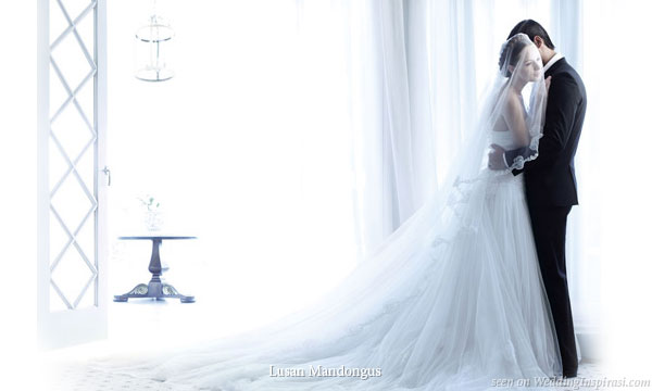 The perfect bridal gown for a romantic white wedding theme by Lusan