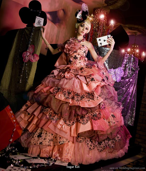 Alice in Wonderland wedding theme photo shoot with cards, coral, salmon pink and brown ruffle bridal gown