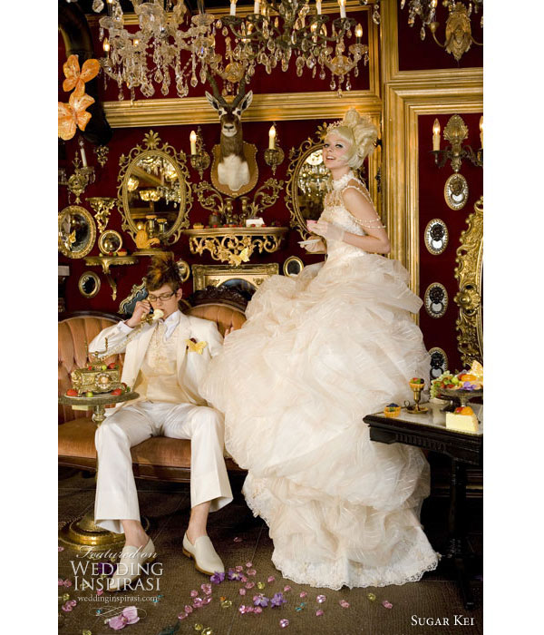 Tea Party or Alice in Wonderland wedding theme. White bridal gown and white tuxedo by Sugar Kei