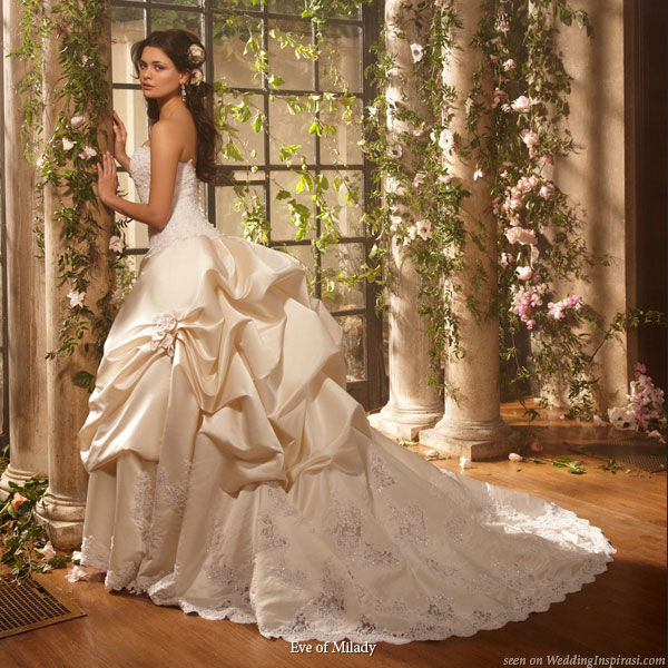 Strapless wedding dress with bustle at the back of the skirt and a short train, from Eve of Milady