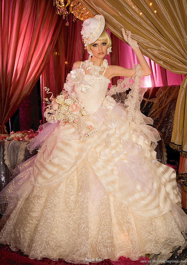 Ballgown wedding dress suitable for a princess bride, wedding hat completes the look