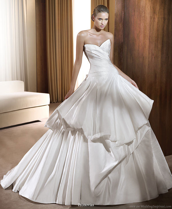 Pronovias 2011 Bridal Gown Collection - Feria strapless sweetheart  neckline wedding dress will ballgown silhoutte and puffy pickup detail  on skirt