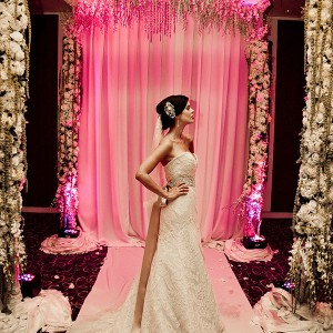 Chuppahs, dripping with crystal and garlands of orchids, by Grande Affaires showed a new trend of a criss-cross designed ceiling. This criss-cross design gave a sloped effect of a 12- foot ceiling raining crystals and orchids over the bride and groom.