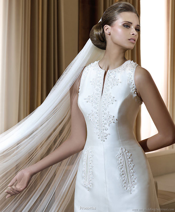 Pronovias 2011 Bridal Gown Collection - Filipinas wedding dress,  smart jewel neckline, flat pockets with embroidery