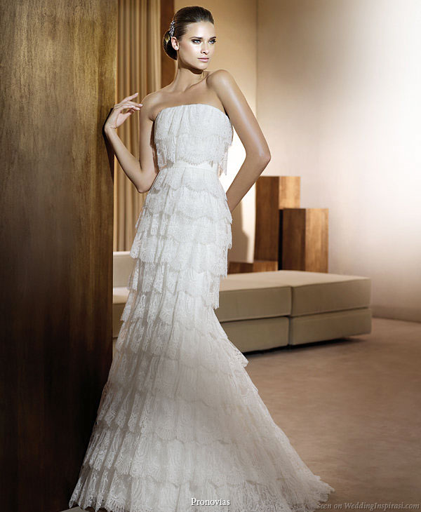 Pronovias 2011 Bridal Gown Collection - Icono wedding dress with  multiple tiers of lace ruffles and volants