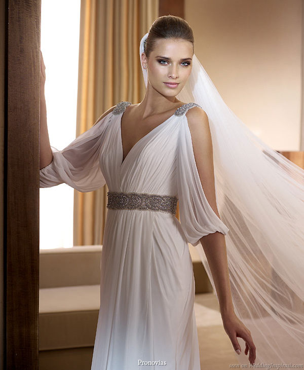 Pronovias 2011 Bridal Gown Collection - Famosa grecian style wedding dress with peekaboo drape sleeves, belt and shoulder accented with crystals or rhinestones