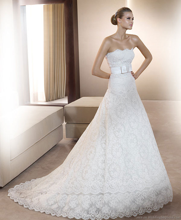 Pronovias 2011 Bridal Gown Collection - Idilio strapless lace wedding dress with matching sash