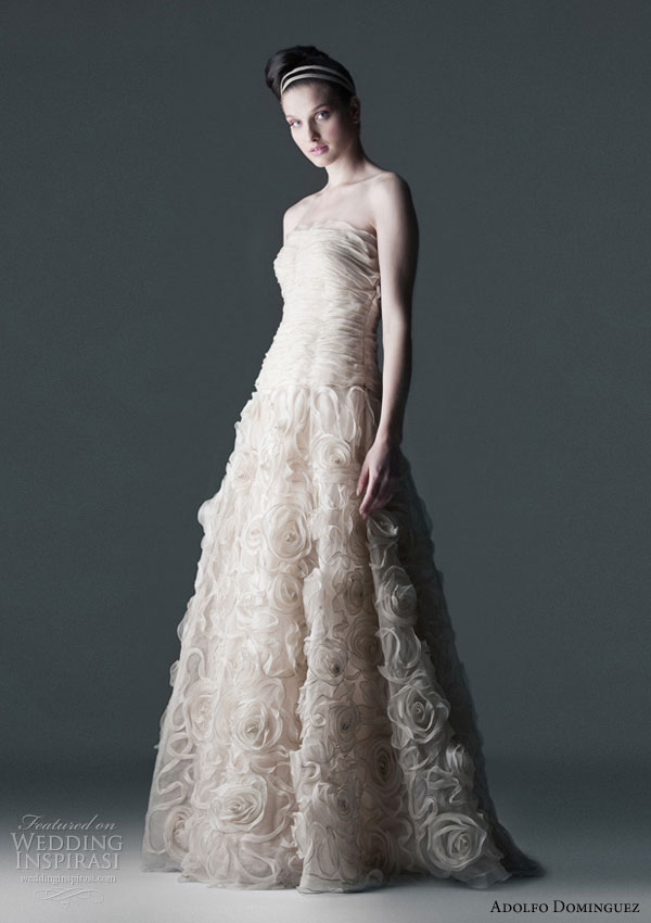 Adolfo Dominguez novias 2010 wedding dress - romantic gown with bodice and skirt draped in cascading ivory organza roses