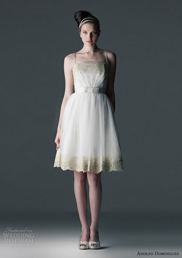 Adolfo Dominguez 2010 wedding gowns - short dress in lace and  tulle finished in gold lurex. bow detail at waist