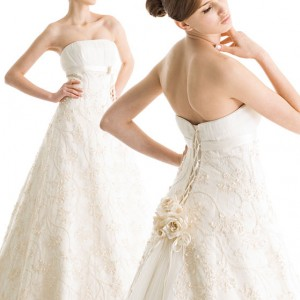 Novestia Bridal Wear strapless white wedding dress with floral embellishment at the back