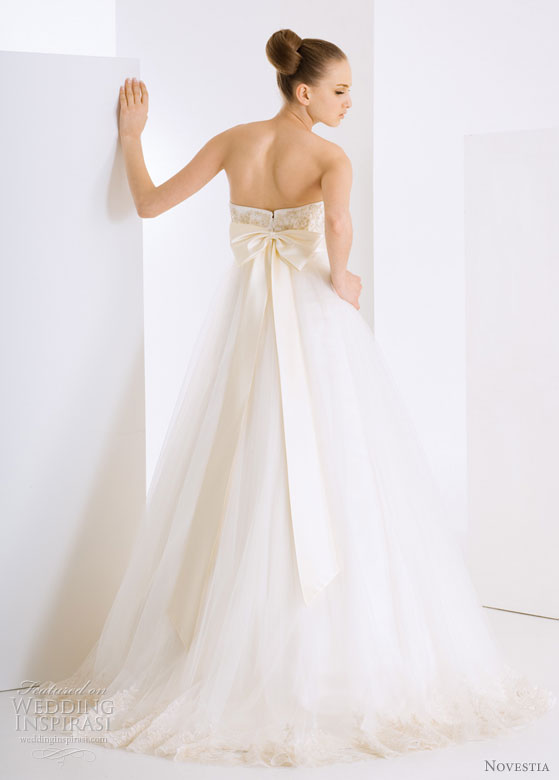 Novestia Bridal Gown collection 2010 - bride models wedding dress showing large bow at back of gown