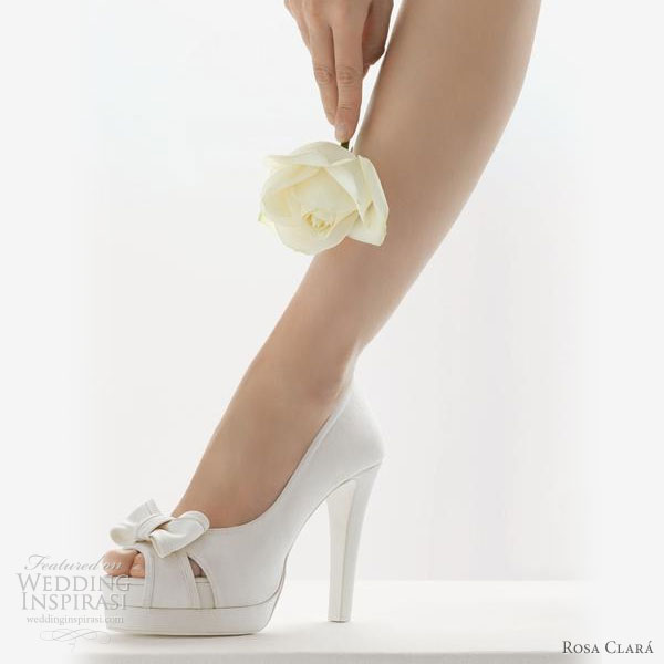 White wedding platform heels with peep toe and bow detail - from Rosa Clara 2010 bridal shoes collection