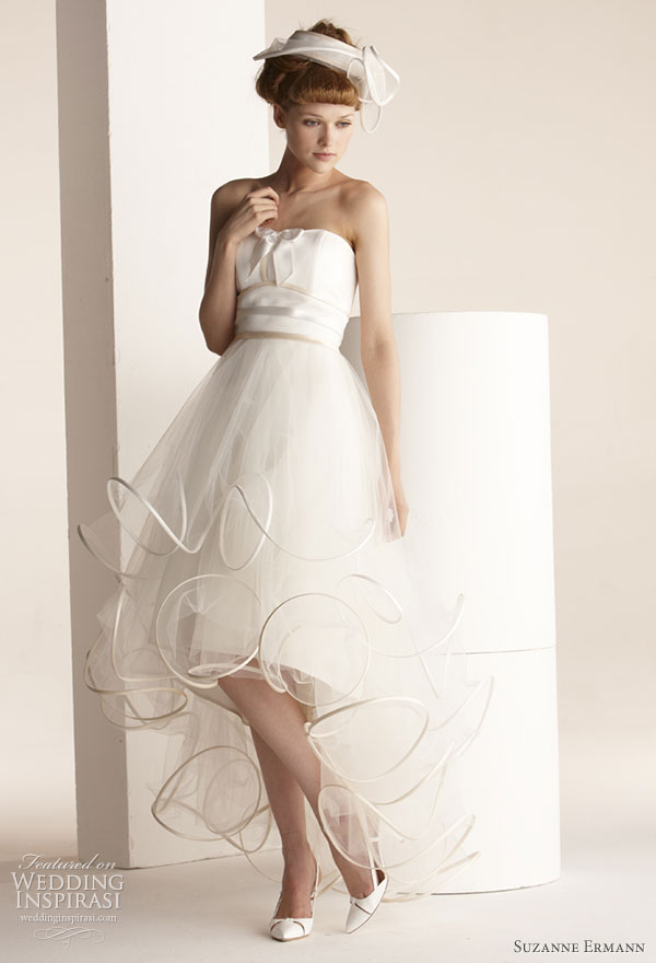 "Suzanne Ermann wedding dresses 2011 SE Marier pret-a-porter bridal collection - Juliette voluminous dress marked size duchess satin, petticoat ""short-long"" scrolls, tulle strapless neckline sewn and quilted through a node."