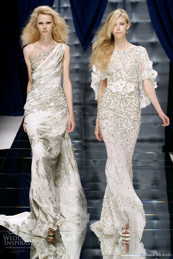A shiny shade of white evening gowns -- one-shoulder and elbow length sleeves-- on models on the runway of Zuhair Murad Couture Fall/Winter 2010-2011 fashion show
