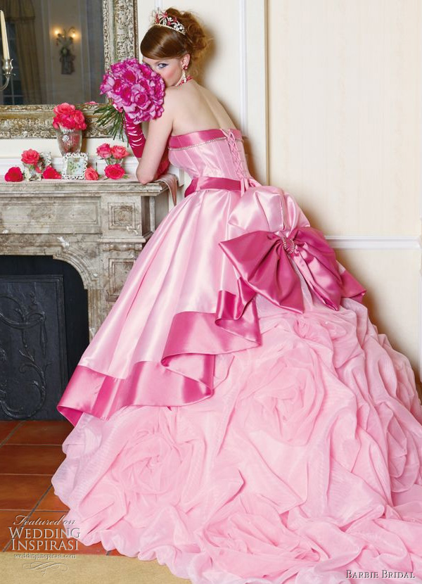 Cute pink wedding dress from Barbie Bridal - hot pink bow at the bustle highlighting gathered ball gown skirt