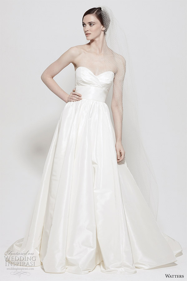 Watters wedding gown from the Spring 2011 collection - Gobi White Silk Taffeta strapless gown with sweetheart neckline, empire band with flower pin and full skirt. Chapel Train.